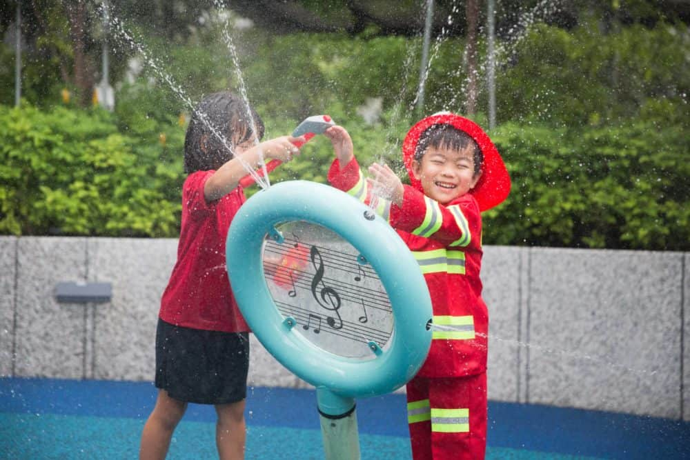 two children water-play learning